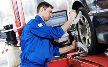 Automobile care through coupons for wheel alignment by Firestone