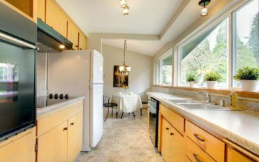 Installing assembled kitchen cabinets saves money and space