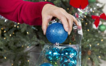 Tips for deciding if a Santa tree topper is right for your tree
